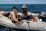 Andy Dunstan and Dr. Peter Ward tracking nautilii with directional radio receiver from zodiak inflateble boat