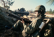 Fort Bragg, North Carolina - January 1980. Photograph taken of members of the 82nd Division carrying out military training maneuvers at Fort Bragg. The 82nd Airborne Division, founded in 1917, is an active duty airborne division of the United States Army, and specializes in parachute assault operations.