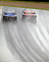 A pair of Daytona Prototypes race up a hill in the rain at the 6 Heueres du Circuit Mont-Tremblant in Mont-Tremblant, Qubec, Canada, on Saturday, May 21, 2005. (Photo by Brian Cleary/www.bcpix.com)