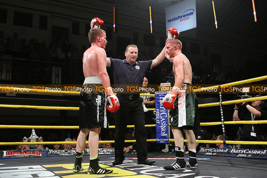 Ryan Taylor (dark green shorts) draws with Dan Carr (black shorts) in a Prizefighter Prospect boxing contest at York Hall, Bethnal Green, promoted by Matchroom Sports - 15/09/11 - MANDATORY CREDIT: Gavin Ellis/TGSPHOTO - Self billing applies where appropriate - 0845 094 6026 - contact@tgsphoto.co.uk - NO UNPAID USE.