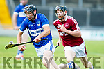 St Brendans Darren Dineen keeps things well balanced while on the run from Colum Harty of Causeway when the sides met in Austin Stack park, Tralee in the County senior hurling championship last Saturday evening.