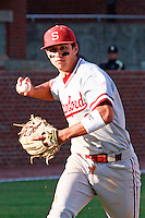 NASHVILLE, TENNESSEE-Feb. 26, 2011:  Kenny Diekroeger of Stanford prepares to throw to first base against Vanderbilt, during a game at Vanderbilt University in Nashville, Tennessee.  Vanderbilt defeated Stanford 8-7.