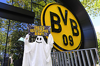 15th May 2020, Signal Iduna Park, Dortmund, Germany; A fan in a ghost costume outside Signal Iduna Park in Dortmund before tomorrow's derby against Schalke with a banner  showing that it is a no-spectator game