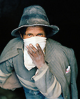 Portrait of a miner holding handkerchief to his mouth, Potosi Mine, Potosi, Eastern Cordillera, Bolivia