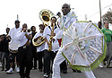 A member of the Sudan Social Aid and Pleasure Club leads the Rebirth Brass Band, New Orleans, Sunday, Nov. 11, 2007.