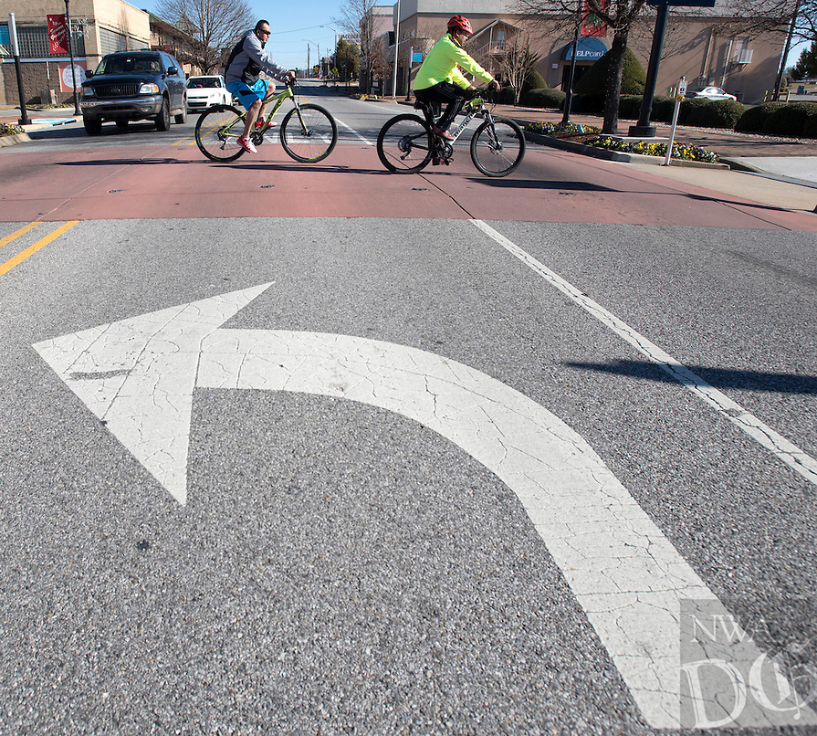 NWA Democrat-Gazette/J.T. WAMPLER A pair of cyclists on the Razorback Regional Greenway cross Emma Ave. in Springdale Sunday Jan. 3, 2016. The Razorback Regional Greenway is a 36 mile long shared-use trail that connects south Fayetteville to Bella Vista.