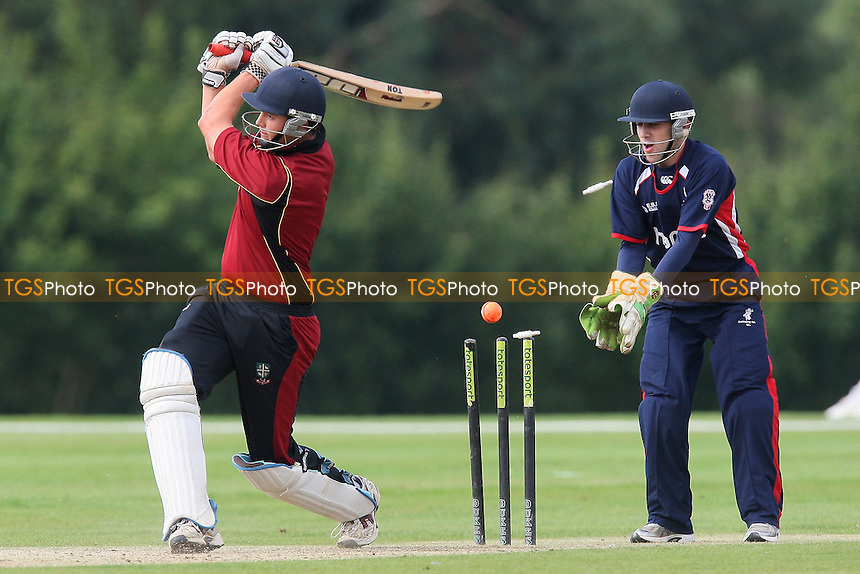 Nick Browne of South Woodford is clean bowled by Josh Peters - South Woodford CC (red) vs Buckhurst Hill CC in the Final - Dukes Essex Twenty 20 Cricket Finals Day at Billericay Cricket Club - 15/08/10 - MANDATORY CREDIT: Gavin Ellis/TGSPHOTO - Self billing applies where appropriate - Tel: 0845 094 6026