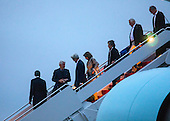 United States President Barack Obama (L), followed by former US President Bill Clinton, US Secretary of State John Kerry, and House Minority Leader Nancy Pelosi walk off Air Force One upon their returns to Andrews Air Force Base form Israel, where they attended the funeral of Shimon Peres, in Maryland, USA, 30 September 2016.<br /> Credit: Jim LoScalzo / Pool via CNP