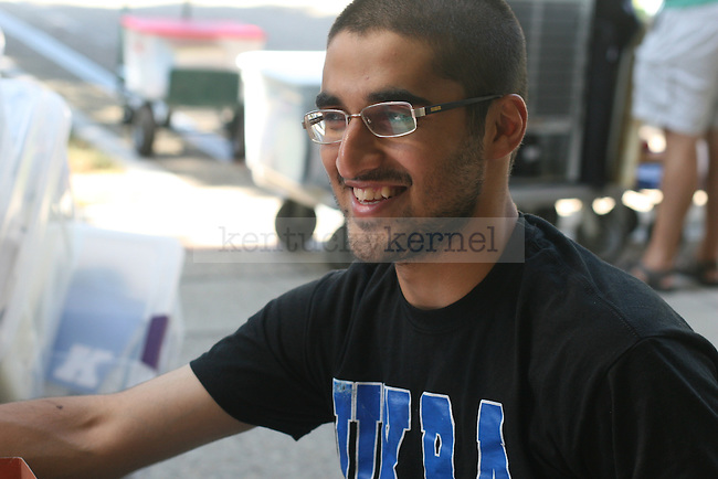 Resident Advisor Mamoon Khattak smiles as he helps out with freshman move in day on August 20, 2010.