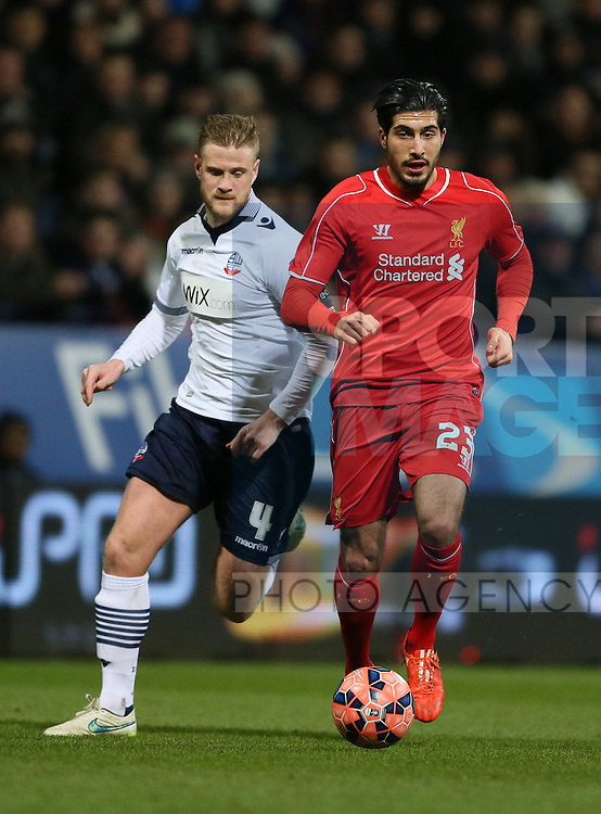 Emre Can of Liverpool gets past Matt Mills of Bolton Wanderers - FA Cup Fourth Round replay - Bolton Wanderers vs Liverpool - Macron Stadium  - Bolton - England - 4th February 2015 - Picture Simon Bellis/Sportimage