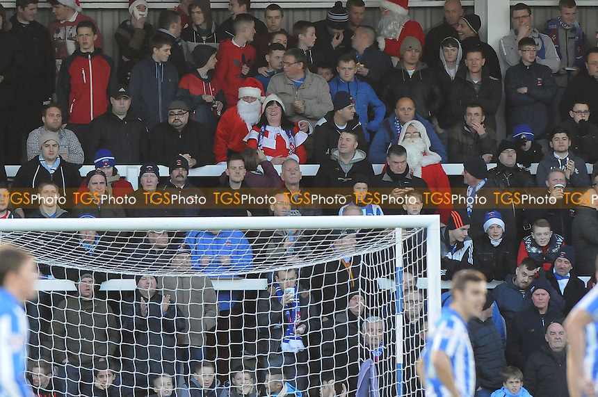 Hartlepool United fans are dressed as Santa Claus - Hartlepool United vs Burton Albion - Sky Bet League Two Football at Victoria Park, Hartlepool, County Durham - 21/12/13 - MANDATORY CREDIT: Steven White/TGSPHOTO - Self billing applies where appropriate - 0845 094 6026 - contact@tgsphoto.co.uk - NO UNPAID USE