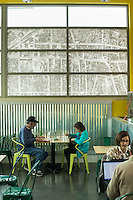 An old aerial map of the West End neighborhood adorns the window above patrons at the Durham Co-op Market Grocery and Cafe in Durham, N.C. on Thursday, March 26, 2015. (Justin Cook)