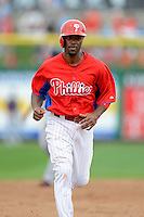 Philadelphia Phillies shortstop Jimmy Rollins #11 runs the bases after Chase Utley (not pictured) hit a home run during a Spring Training game against the Boston Red Sox at Bright House Field on March 24, 2013 in Clearwater, Florida.  Boston defeated Philadelphia 7-6.  (Mike Janes/Four Seam Images)
