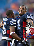 26 November 2006: Buffalo Bills tight end Robert Royal (84) celebrates with cornerback Kiwaukee Thomas (25) after a game against the Jacksonville Jaguars at Ralph Wilson Stadium in Orchard Park, NY. The Bills defeated the Jaguars 27-24. Mandatory Photo Credit: Ed Wolfstein Photo<br />