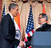 United States President Barack Obama, left, shakes hands with Foreign Minister S.M. Krishna of India at a reception in the Minister's honor at the State Department  in Washington, D.C. on Thursday, June 3, 2010..Credit: Ron Sachs - Pool via CNP