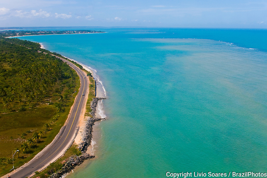 Road and tropical beach at Porto Seguro, in the state of Bahia, Brazil. The first spot reached by the Portuguese colonizers when they first arrived in Brazil in 1500.
