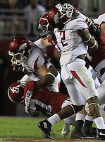 Arkansas Democrat-Gazette/BENJAMIN KRAIN --10/10/15--<br /> Arkansas punter Toby Baker (37), left, is brought down by the Alabama defense after attempting a fake punt in the third quarter of the Razorbacks 27-14 loss.