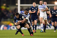 Luke McGrath of Leinster Rugby is tackled by Semesa Rokoduguni of Bath Rugby. Heineken Champions Cup match, between Leinster Rugby and Bath Rugby on December 15, 2018 at the Aviva Stadium in Dublin, Republic of Ireland. Photo by: Patrick Khachfe / Onside Images