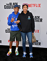 "LOS ANGELES, USA. June 04, 2019: Pharrell Williams & Helen Lasichanh at the premiere for ""The Black Godfather"" at Paramount Theatre.<br /> Picture: Paul Smith/Featureflash"