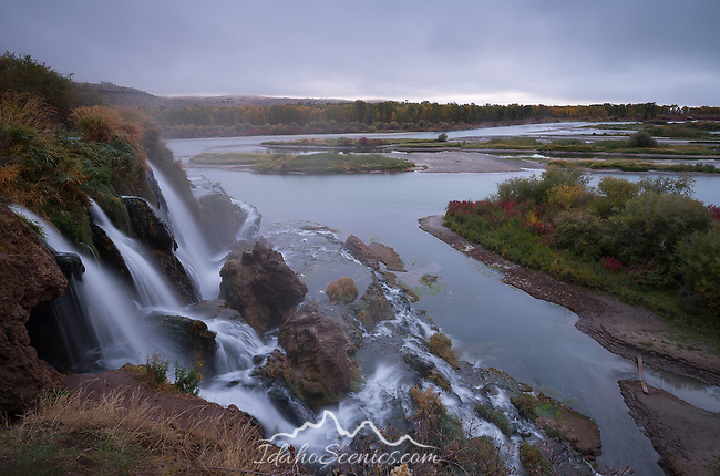 Idaho, Eastern, Swan Valley. Fall Creek Falls and the South Fork of the Snake River at dawn in autumn.