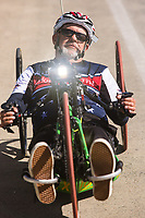 Morehead City, NC -- Quadriplegic hand cyclist Paul Kelly, 62, climbs the bridge to Atlantic Beach over the intercostal waterway on a training ride for the Boston Marathon. The strenuous climb can take 10 minutes. Tuesday, March 27, 2018. (Justin Cook for The Wall Street Journal)<br /> <br /> SUMMARY:<br /> <br /> Paul Kelly, hand cyclist, Beaufort, NC Training for the Boston Marathon so we would want to shoot in March to run the week before the marathon or marathon Monday, Apriln16. Life as a quadriplegic doesn't keep 62-year-old Paul Kelly on the sidelines. After breaking his neck in a swimming accident in 1978, Kelly was determined to find fitness activities to maintain an active lifestyle. He discovered handcycles while watching his niece compete in the 2006 Marine Corps Marathon and was inspired to start his own marathon career to stay fit. Paul has competed in over 100 half and full marathons. On April 16, he will celebrate his 40th year of living as a quadriplegic by taking on one of the most coveted races for a marathoner -- the Boston Marathon. Kelly is among the 60 handcyclists competing in the 2018 Boston Marathon with a qualifying time of 1:26:37. Most of Paul's distance training takes place at Bogue Banks, which includes Atlantic Beach, Salter Path, and Emerald Isle, N.C. It's Nicholas Sparks worthy scenery with its marshes, waterways, inlets and small islands. Paul is particularly fond of the approach from Atlantic Beach to Bogue Banks -- it's via the high-rise bridge. In cold weather, Paul has to be mindful of the environment and dress in a manner that insulates his legs while also allowing his upper body to ventilate. Paul chooses to train at times of day when the temperatures are more reasonable. He uses hand warmers in his gloves, on the inside the grips on his handcycle and in the legs of his trousers.