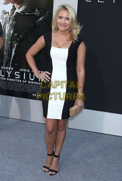 Emily Osment<br /> &quot;Elysium&quot; Los Angeles Premiere held at the Regency Village Theatre, Westwood, California, UK,<br /> 7th August 2013.<br /> full length black dress white stripe hand on hip <br /> CAP/ADM/RE<br /> &copy;Russ Elliot/AdMedia/Capital Pictures