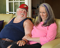 STAFF PHOTO ANDY SHUPE - Pam  Foster, seen here with her husband, Jack Foster Friday, July 25,  2014, writes about her experience being married to Jack, who was diagnosed with post-traumatic stress disorder after his service as a marine in the Vietnam War.