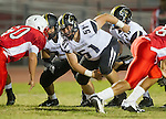 Lawndale, CA 09/26/14 - Jacob Rathbun (Peninsula #51) and Daniel Schubert (Peninsula #18) in action during the Palos Verdes Peninsula vs Lawndale CIF Varsity football game at Lawndale High School.  Lawndale defeated Peninsula 42-21