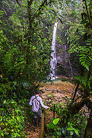 Person at Waterfall San Vincente in an area of jungle called Mashpi Cloud Forest in the Choco Rainforest, Ecuador, South America