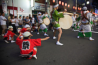Groups of choreographed dancers and musicians known as ren dance through the streets at summer festivals in Japan, typically accompanied by the shamisen lute, taiko drums, shinobue flute and the kane bell. Performers wear traditional obon dance costumes, or summer kimono, and chant and sing as they parade through the streets.  Originally from Tokushima, Shikoku, its popularity has spread through Japan and is now a standard feature of summer festivals throughout the country.