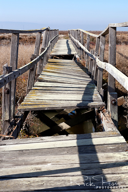 A foot bridge crosses the marsh at the ghost town of Drawbridge in southern San Francisco Bay. Drawbridge was a hunting village started in the 1880's with the last resident leaving in the 1970's.