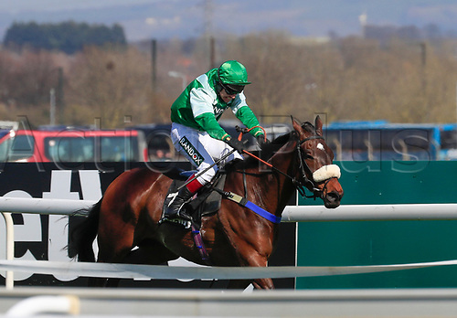 14h April 2018, Aintree Racecourse, Liverpool, England; The 2018 Grand National horse racing festival sponsored by Randox Health, day 3;  Richard Johnston rides Thomas Patrick to the line to win The Betway Handicap Steeple Chase