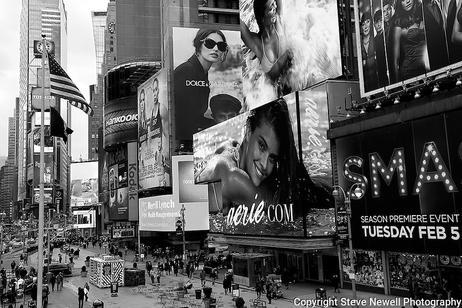 """Aerie"" Black and White Times Square Manhattan New York. Times Square is like a little city all to itself that provides plenty of entertainment, bars, restaurants, shopping and attractions for everyone.  You can't possibly do and see it all in a one week vacation. I went to two Broadway plays and one off broadway play while I was staying in Manhattan for eight days shooting photography.  The local employees recommended their favorite restaurants and bars in the area that were excellent and affordable.  Times Square has so much to offer everyone from all walks of life will be satisfied on a visit to the must see district. I made several trips to the area spanning morning noon and night- to late night. When the huge storm blew into New York on the weekend I found myself in the middle of Times Square alone enjoying the light snow fall.  A memory I will cherish!"