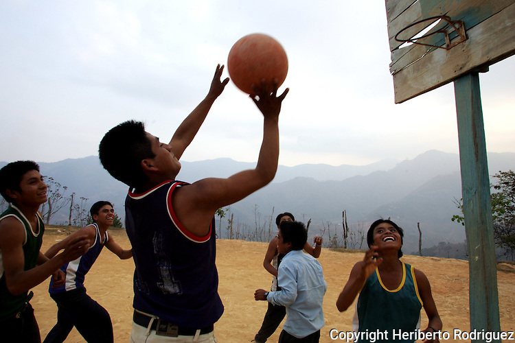 Native children play basketball in their primary school's court in the village of Xaagundutia, in southern state of Guerrero. Photo by Heriberto Rodriguez