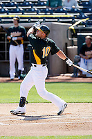 Daric Barton #10 of the Oakland Athletics bats in an intrasquad game during spring training workouts at Phoenix Municipal Stadium on February 24, 2011  in Phoenix, Arizona. .Photo by:  Bill Mitchell/Four Seam Images.