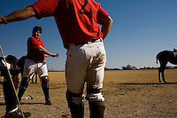 JOHANNESBURG, SOUTH AFRICA - JULY 16:   Polo players stretch before a match in Johannesburg, South Africa.  (Photo by Landon Nordeman)