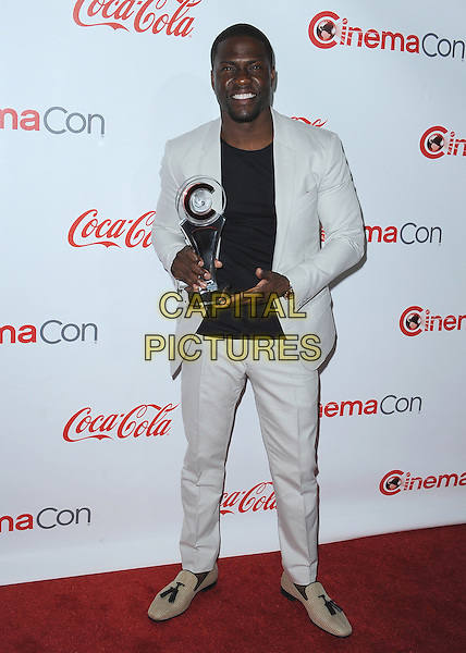 LAS VEGAS, CA - APRIL 23:  Kevin Hart poses with the Big Screen Achievement Award at the CinemaCon 2015 Big Screen Achievement Awards at the Colosseum at Caesars Palace on April 23, 2015 in Las Vegas, Nevada. <br /> CAP/MPI/PGSK<br /> &copy;PGSK/MediaPunch/Capital Pictures