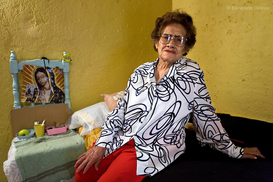 Portrait of Josefina, a resident of Casa Xochiquetzal, in her room at the shelter in Mexico City on March 14, 2008. Casa Xochiquetzal is a shelter for elderly sex workers in Mexico City. It gives the women refuge, food, health services, a space to learn about their human rights and courses to help them rediscover their self-confidence and deal with traumatic aspects of their lives. Casa Xochiquetzal provides a space to age with dignity for a group of vulnerable women who are often invisible to society at large. It is the only such shelter existing in Latin America. Photo by Bénédicte Desrus