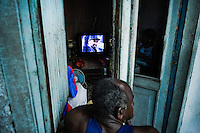A Cuban man watches TV broadcasting of the Cuban Revolution anniversary celebration in Santiago de Cuba, Cuba, 26 July 2008. The Cuban revolution began when the poorly armed Cuban rebels, led by Fidel Castro, attacked the Moncada Barracks in Santiago de Cuba on 26 July 1953. The attack was easily defeated and most of the rebels were captured and later executed by the Batista regime. Although Fidel Castro had been sentenced to 15 years of prison, after less than two years he was released, he went to Mexico and in 1956, back in Cuba again, his guerilla group started a new rebellion.