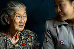 Sosorbaram, an 82-year-old woman in Khanuul, a ger (tent) district of Ulan Batur, talks to Red Cross Volunteer, Yunbat.<br />
