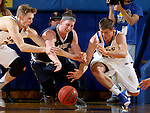 BROOKINGS, SD - NOVEMBER 3:  A.J. Hess #35 and 	Lane Severyn #25 from South Dakota State dive for the loose ball with Konor Kulas #14 from SD School of Mines in the first half of their exhibition game Thursday evening at Frost Arena in Brookings. (Photo by Dave Eggen/Inertia)