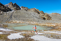 Running near the Lac du Grand Désert during the Via Valais, a multi-day trail running tour connecting Verbier with Zermatt, Switzerland.