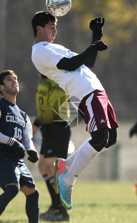 Lindenwood-Belleville hosted Columbia College on Friday afternoon to determine an AMC Conference champion and which team would go on to the NAIA National Men's Soccer Championship. Lindenwood's Enrique Garcia (19) jumps to head the ball in the second half. At left watching is Columbia College's Edin Campara (10).