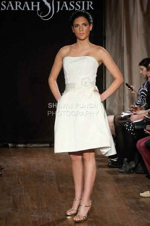 """Model walks runway in a Loulou Bridal dress - strapless short satin dress with sequin bodice, by Sarah Jassir, for the Sarah Jassir Spring 2013 """"La Reve: The Dream"""" collection, during Bridal Fashion Week New York."""