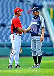 21 June 2011: Seattle Mariners right fielder Ichiro Suzuki chats with Washington Nationals Manager Jim Riggleman prior to a game against the Washington Nationals at Nationals Park in Washington, District of Columbia. The Nationals rallied from a 5-1 deficit, scoring 5 runs in the bottom of the 9th, to defeat the Mariners 6-5 in inter-league play. Mandatory Credit: Ed Wolfstein Photo