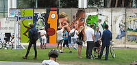 Portions of the Berlin Wall installed along Wilshire Blvd. by the Wende Museum seen during CicLAvia's June 2013 event where 6 miles of Wilshire Blvd. were closed to cars (thus explaining why so many bicyclists are in the picture).