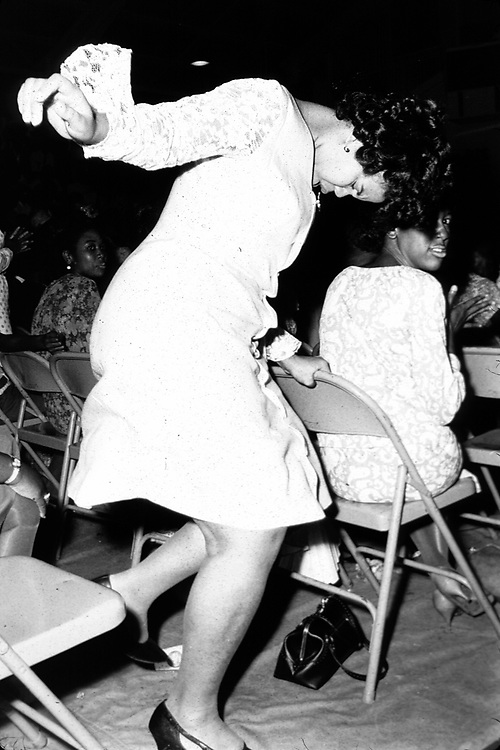 Woman at gospel show at Alabama State College, Montgomery Ala, dances to the music. Copyright Jim Peppler/1967. This and over 10,000 other images are part of the Jim Peppler Collection at The Alabama Department of Archives and History:  http://digital.archives.alabama.gov/cdm4/peppler.php