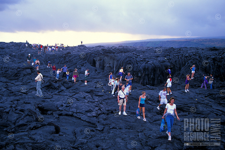 Visitors from around the world drive the Chain of Craters road to trek across old lava flows to get a close up view of new lava flowing into the ocean.  Hawaii Volcanoes National Park.