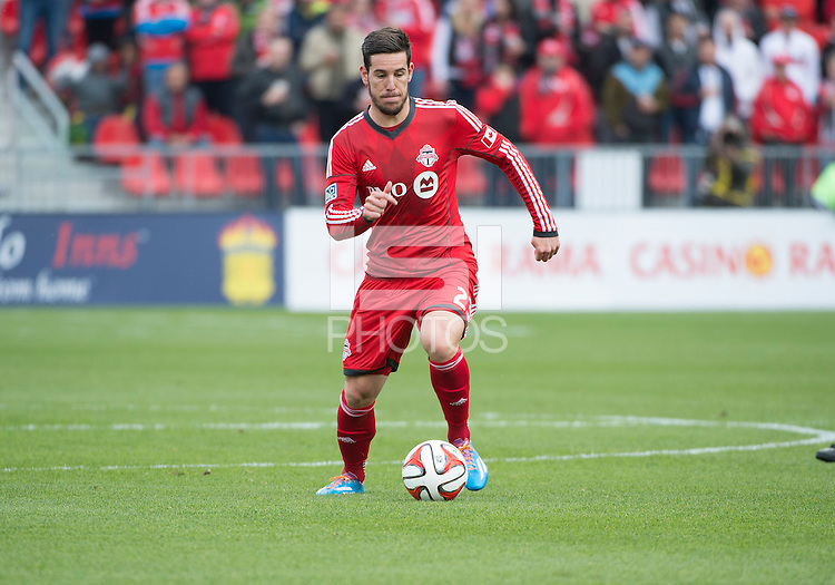 Toronto, Ontario - May 17, 2014: Toronto FC midfielder Alvaro Rey #23 in action during a game between the New York Red Bulls and Toronto FC at BMO Field. Toronto FC won 2-0.