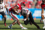 Nyheim Hines (7) of the North Carolina State Wolfpack is hit by T.J. Brunson (6) of the South Carolina Gamecocks during second half action in the Belk College Kickoff at Bank of America Stadium on September 2, 2017 in Charlotte, North Carolina.  The Gamecocks defeated the Wolfpack 35-28.  (Brian Westerholt/Four Seam Images)